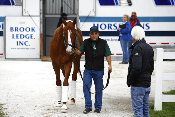 Kentucky Derby winner Justify arrives at Pimlico Race Course as trainer Bob Baffert (right) awaits on Wednesday, May 16, 2018, in Baltimore.