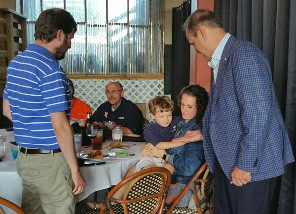 Auburn defensive coordinator Kevin Steele interacts with a young fan at the Gulf Coast Spring Tiger Walk, a joint meeting of the Mobile Auburn Club and the Mississippi Gulf Coast Auburn Club at Ralph and Kacoo's in Spanish Fort, Ala., on Monday, April 23, 2018.