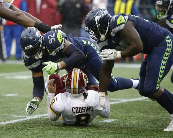e21e6ed59d2 Seattle Seahawks defensive tackles Jarran Reed (right) and Nazair Jones  take down Washington Redskins