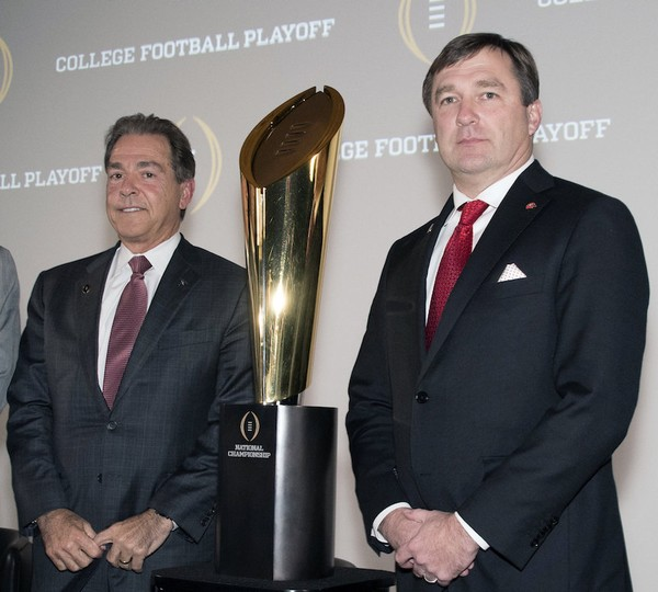 Nick Saban, of Alabama, left, and Kirby Smart, right, of Georgia pose together before the College Football Awards show at the College Football Hall of Fame, Thursday, Dec. 7, 2017, in Atlanta. (AP Photo/John Amis)