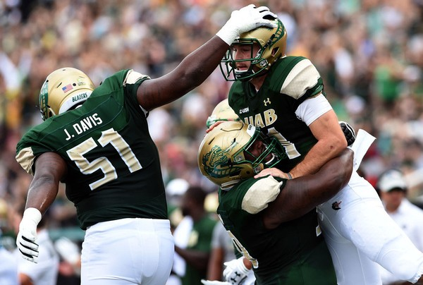UAB offensive lineman Malique Johnson lifts UAB quarterback A.J. Erdely after he scored a touchdown at Legion Field. (Mark Almond for AL.com)