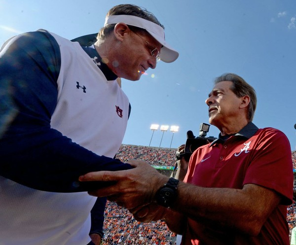 Coaches Gus Malzahn (left) of Auburn and Nick Saban of Alabama shake hands before the Iron Bowl on Nov. 28, 2015, at Jordan-Hare Stadium in Auburn, Ala.