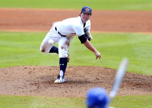 Auburn pitcher Tanner Burns throws against Florida during the fifth inning of an NCAA Super Regional college baseball game Sunday, June 10, 2018, in Gainesville, Fla. (AP Photo/Matt Stamey)