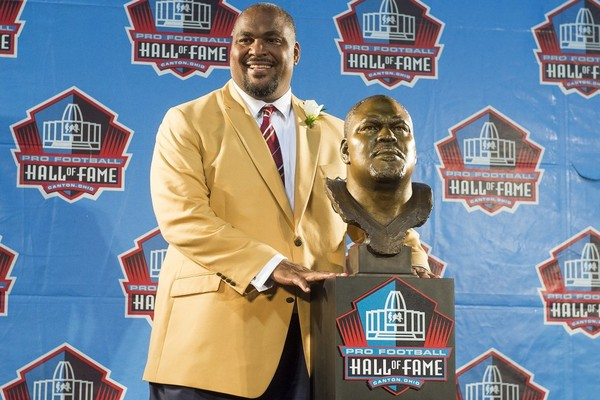 Former Seattle Seahawks tackle Walter Jones with his bust during the Class of 2014's Pro Football Hall of Fame enshrinement ceremony at Fawcett Stadium on Aug. 2, 2014, in Canton, Ohio.