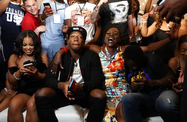 Alabama wide receiver Calvin Ridley (center), his mother, Kassna Daniels (right); and girlfriend, Dominique Fitchard; react as they watch his name announced on television as the 26th player picked in the NFL Draft during a watch party in Fort Lauderdale, Fla., on Thursday, April 26, 2018.