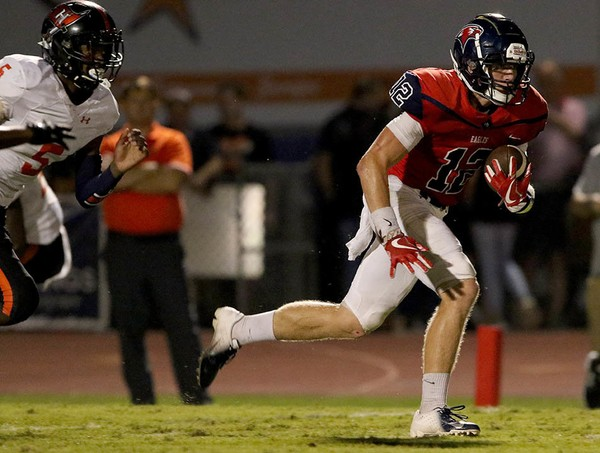 Oak Mountain's Luke Percer finds an opening in the Hoover defense for a 96-yard touchdown run during a high school football game at Heardmont Park in Birmingham, Ala., Friday, Sept. 21, 2018. (Dennis Victory/preps@al.com)