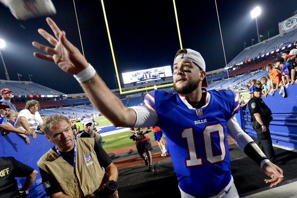 Buffalo Bills quarterback AJ McCarron flips a towel to a fan after an NFL preseason game against the Carolina Panthers at New Era Field in Orchard Park, N.Y., on Thursday, Aug. 9, 2018.