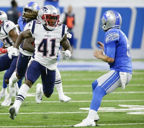 New England Patriots cornerback Cyrus Jones blocks during a punt return in an NFL game against the Detroit Lions on Sept. 23, 2018, in Detroit.
