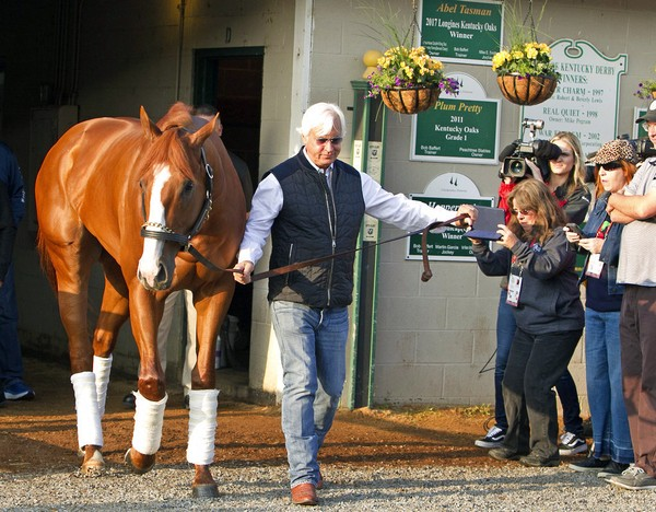 Trainer Bob Baffert leads Justify out of Barn 33 at Churchill Downs on May 6, 2018, the day after the colt won the Kentucky Derby in Louisville, Ky.