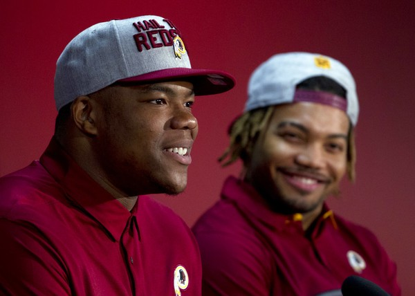 Washington Redskins first-round draft choice Da'Ron Payne, (left) speaks during a press conference as second-round choice Derrius Guice watches in Landover, Md., on April 28, 2018.