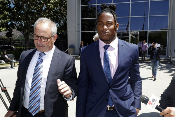San Francisco 49ers linebacker Reuben Foster (right) leaves the Santa Clara County Hall of Justice with his attorney Joshua Bentley after a preliminary hearing on Thursday, May 17, 2018, in San Jose, Calif.