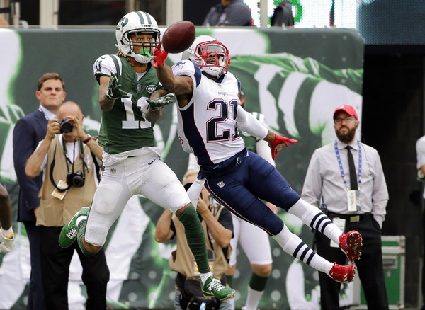 New England Patriots cornerback Malcolm Butler (21) breaks up a pass to New York Jets wide receiver Robby Anderson during an NFL game on Oct. 15, 2017, in East Rutherford, N.J.