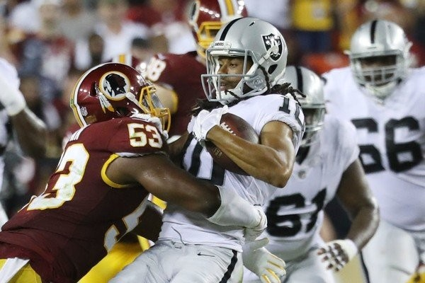 Washington Redskins outside linebacker Ryan Anderson tackles Oakland Raiders wide receiver Seth Roberts during an NFL game on Sept. 24, 2017, at FedEx Field in Landover, Md.