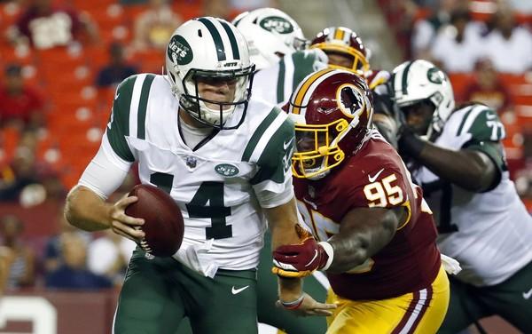 Washington Redskins defensive tackle Da'Ron Payne sacks New York Jets quarterback Sam Darnold during an NFL preseason game on Thursday, Aug. 16, 2018, in Landover, Md.