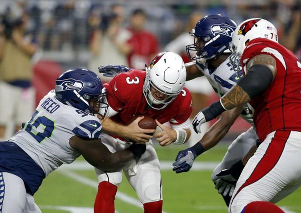 Seattle Seahawks defensive tackle Jarran Reed (90) sacks Arizona Cardinals quarterback Josh Rosen during an NFL game on Sept. 30, 2018, in Glendale, Ariz.