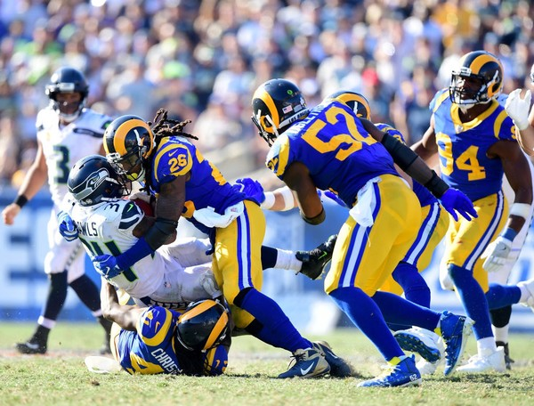 Los Angeles Rams inside linebacker Mark Barron tackles Seattle Seahawks running back Thomas Rawls during an NFL game on Oct. 8, 2017, at Los Angeles Memorial Coliseum.