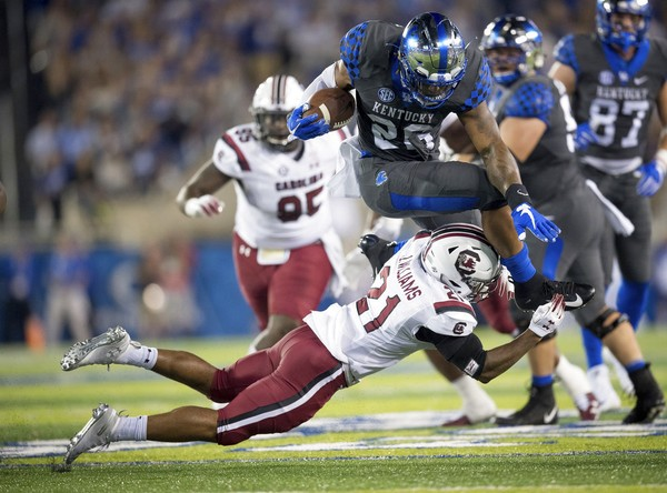Kentucky running back Benny Snell Jr. jumps over South Carolina defensive back Jamyest Williams during an SEC game on Saturday, Sept. 29, 2018, at Kroger Field in Lexington, Ky. The Wildcats defeated the Gamecocks 24-10 to improve to 5-0.