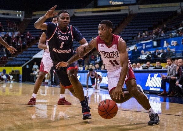 Troy's B.J. Miller, right, dribbles past South Alabama's Herb McGee in a 2018 game. (File photo)