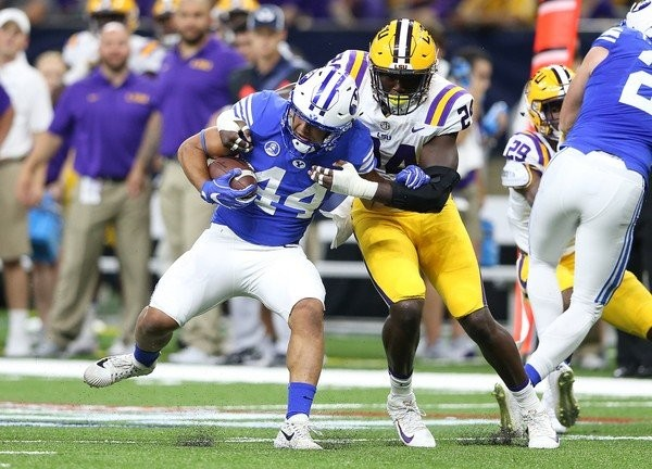 LSU linebacker Tyler Taylor (24) wraps up Brigham Young Cougars running back Kavika Fonua (44) in the first quarter during Texas Kickoff game between the BYU Cougars and LSU Tigers at the Superdome on Saturday, September 2, 2017. (Photo by Michael DeMocker, NOLA.com | The Times-Picayune)