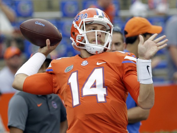 Florida quarterback Luke Del Rio (14) warms up before an NCAA college football game against Vanderbilt, Saturday, Sept. 30, 2017, in Gainesville, Fla. (AP Photo/John Raoux)