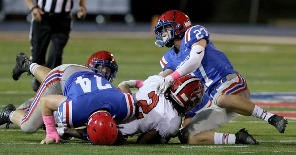 Vestavia Hills' Will Brooks, right, helps bring down Hewitt-Trussville's Armoni Goodwin during a high school football game at Thompson Reynolds Stadium in Vestavia Hills, Ala., Friday, Oct. 5, 2018. (Dennis Victory/preps@al.com) Dennis Victory