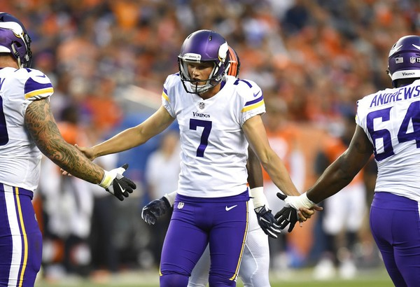 Minnesota Vikings place-kicker Daniel Carlson receives congratulations from teammates after kicking a field goal in the first half of an NFL preseason game against the Denver Broncos on Saturday, Aug. 11, 2018, in Denver.