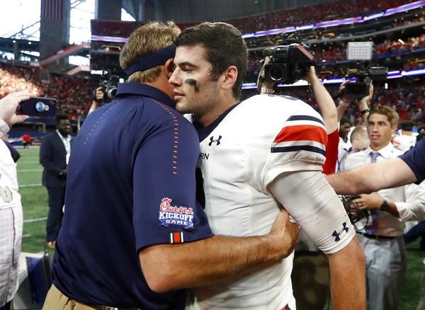 Auburn quarterback Jarrett Stidham gets a hug from coach Gus Malzahn after the Tigers defeated Washington on Sept. 1, 2018, in Atlanta.