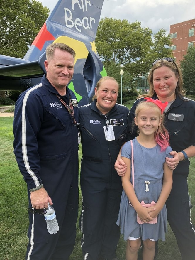 Jocelyn Traw, 9, of Mineral Ridge, was transported to Akron Children's Hospital via Air Bear after being hit by a car while riding her bike. Here she poses with crew members MedTrans pilot Bill Knisley, Respiratory Therapist Summer Oney and Pediatric Nurse Sarah Dech.