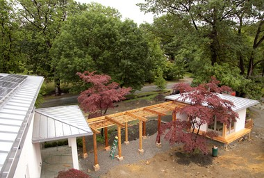 The pergola and teahouse next to the Butler-Nissen house as viewed from above.