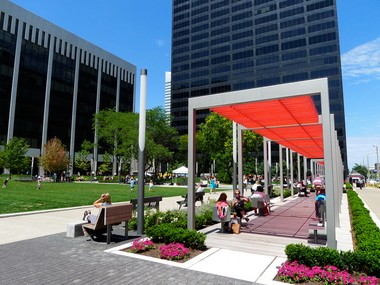 The popular makeover of Perk Park, designed by Thomas Balsley of New York with James McKnight of Cleveland, is lifting values in adjacent buildings.