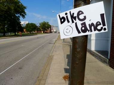 A handmade sign proclaimed the arrival of a new amenity for cyclists on Detroit Avenue Monday.