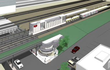 A bird's eye view of the new RTA Little Italy Red Line Rapid Station. The disused railroad overpass closest to the station, with greenery instead of tracks, will be removed.
