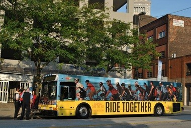 "A Greater Cleveland Regional Transit Authority bus is part of the Bike Cleveland citywide safety campaign called ""Ride Together."""
