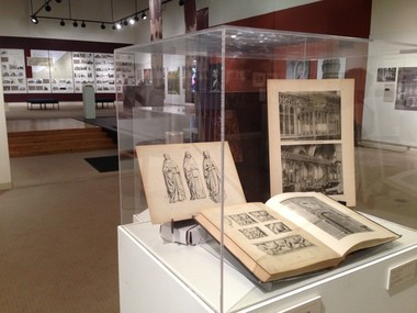 A display case in the Charles Schweinfurth exhibition at ARTneo in Lakewood shows off items from the Schweinfurth Collection at the Cleveland Public Library.