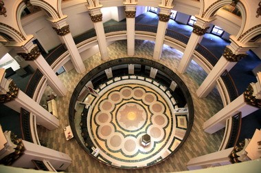 Architect George Browne Post designed the Ameritrust Rotunda in Cleveland with 13 columns to reconcile the building's interior with the odd shape of its site, formed by the acute angle of Euclid Avenue with East Ninth Street.