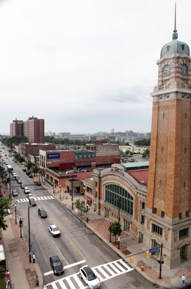 The 101-year-old West Side Market, at right, has anchored an urban revival along Lorain Avenue and West 25th Street, shown here, looking north.