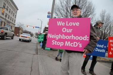 George Hrbek, foreground, joined over a dozen others in a protest at the site of a proposed McDonalds to be built at the corner of Fulton and West 38th St., on Friday, Nov. 30, 2012.