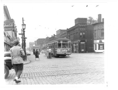 Streetcars once coursed up and down Lorain Avenue, as this 1952 photograph shows.