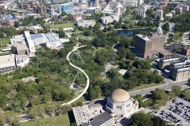 A bird's eye view of the S-shaped pedestrian bridge proposed by Miguel Rosales in 2011 for CWRU that would cross Rockefeller Park, connecting the Cleveland Museum of Art to the Temple-Tifereth Israel.