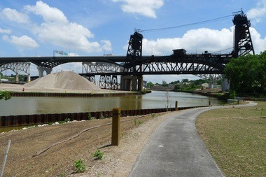 The view looking south from the new Scranton/Flats trail includes the Norfolk-Southern rail bridge over the Cuyahoga River, plus the completed new I-90 bridge, and the old I-90 bridge, now under demolition.