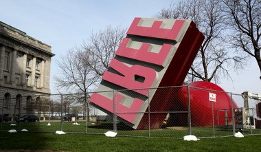 """The Claes Oldenburg """"Free Stamp"""" sculpture in Willard Park, shown in May at the start of a restoration project."""