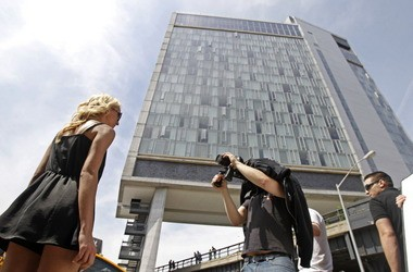 A cameraman shoots video footage of model Karina Korcakova in 2011, left, for a music video with the Standard Hotel, hovering over the High Line in New York.
