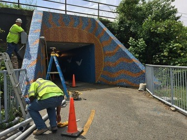 ODOT subcontractors on Wednesday built an electrical conduit through the West 65th Street lakefront access tunnel to power equipment needed for the re-do of the West Shoreway.