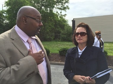 Jeffery K. Patterson, chief executive officer and safety director of the Cuyahoga Metropolitan Housing Authority, speaking with HUD's Harriet Tregoning on Monday during a tour of Opportunity Corridor in Cleveland.