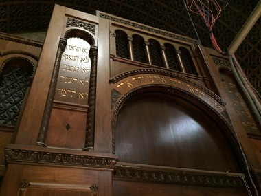 Once a new acoustical canopy is finished and raised to its final position, the carved wooden facade of the Temple-Tifereth Israel's ark and choir loft will be fully visible in the Temple's new role as a performing arts center. The woodwork, shown here, includes the Ten Commandments and the Sh'mah, in Hebrew.