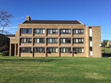 A Peter van Dijk dormitory at Ursuline College shows influences including the architecture of Eero Saarinen and 1960s Brutalism.