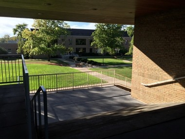 The passageway under the Mullen Building at Ursuline College leads to an overlook with an enticing view of the quadrangle beyond and below.