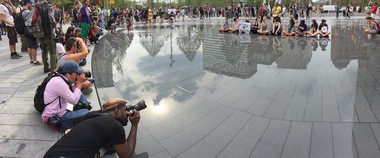 Photographers clustered around Public Square's new water feature looking for shots on Thursday, July 21, Day 4 of the Republican National Convention.