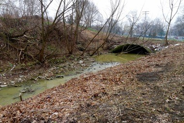 Doan Brook emerges from a culvert west of the Cleveland Museum of Art, on the north side of the site of the Nord Family Greenway, now under construction. The Northeast Ohio Regional Sewer District plans to redirect the flow of the brook away from the eroding hillside west of the museum's main access driveway.