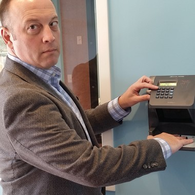 Eric Baker, who runs the newest Goddard School in Avon Lake, demonstrates one of many safety features in the school.